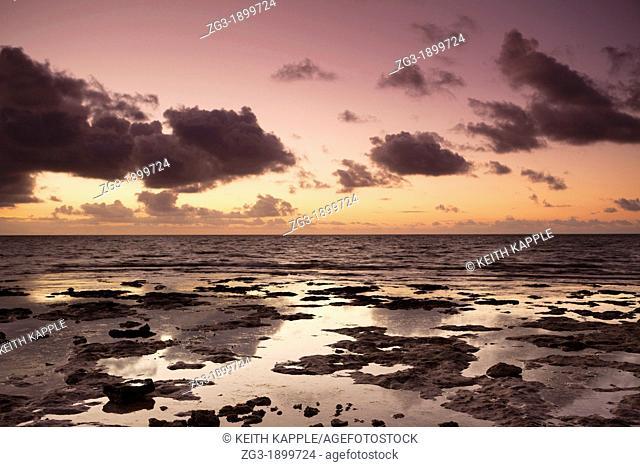 Dawn sunlight and rocky coast at Spanish Key, Florida, USA