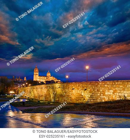 Salamanca skyline sunset and roman bridge over Tormes river in Spain