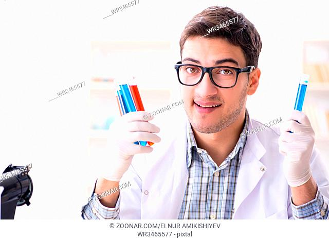 Chemistry student doing chemical experiments at classroom activity