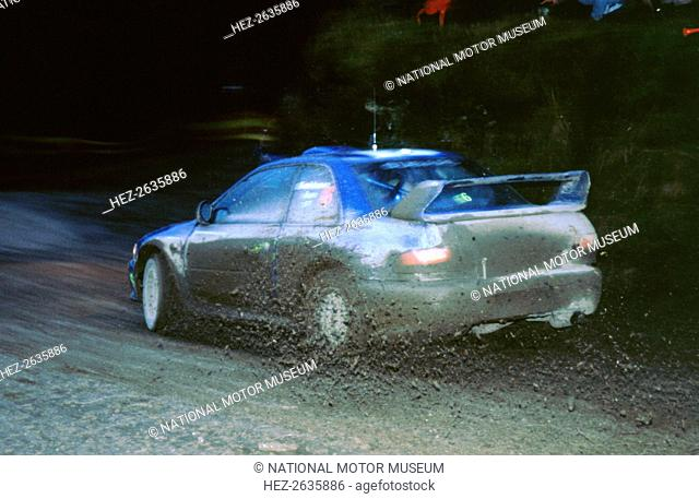 Juha Kankkunen, 1999 Subaru Impreza, WRC Network Q Rally. Artist: Unknown