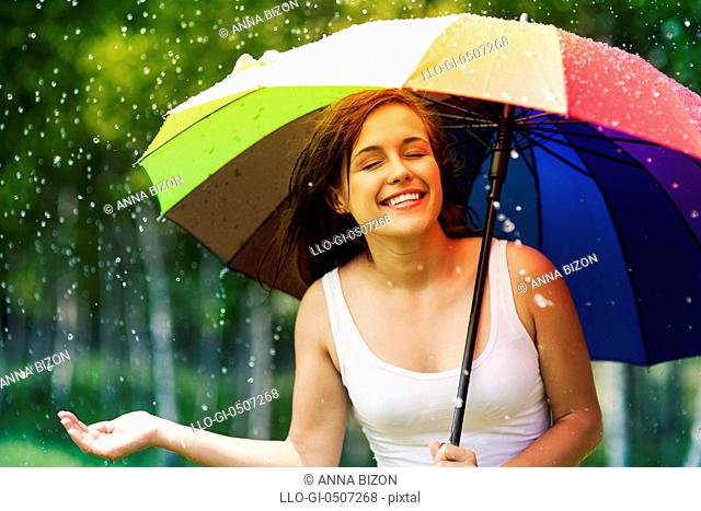 Beautiful woman enjoying summer rain, Debica, Poland