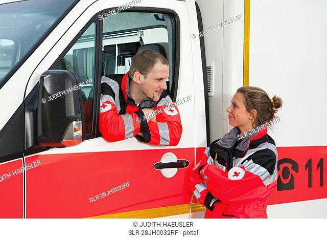 Ambulance man talking to colleague