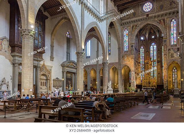 Florence, Tuscany, Italy. Santa Croce Basilica. View along length of nave to altar