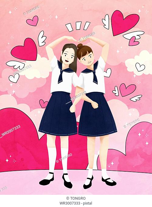 Two smiling school girls making a heart