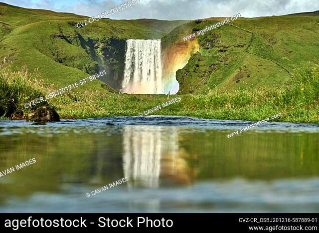 Pond with hills with waterfall