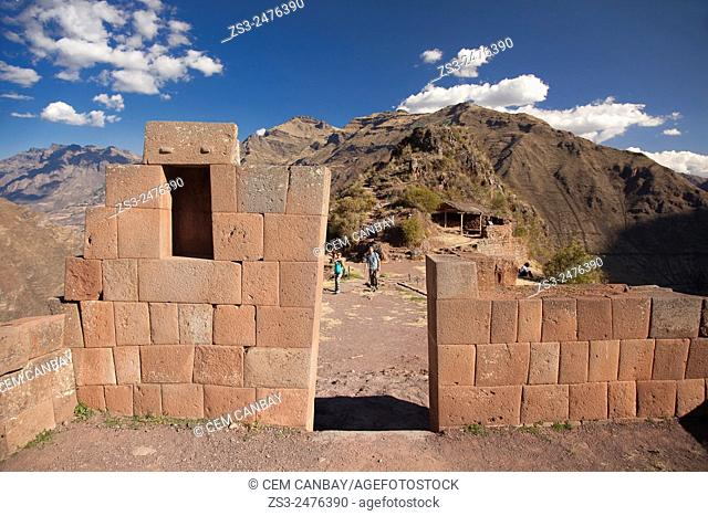 Tourists near the Inca terraces of the ancient Inca settlement, Pisac Ruins , Cusco Region, Peru, South America