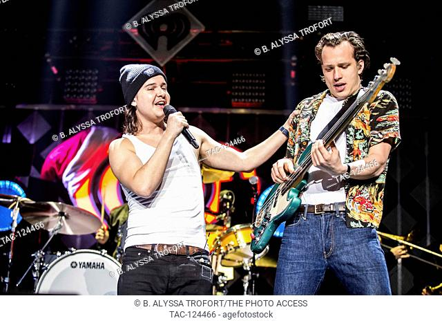 Lukas Forchhammer and bassist Magnus Larsson of Lukas Graham performs at the POWER 96.1's iHeart Radio Jingle Ball presented by Capital One at the Phillips...
