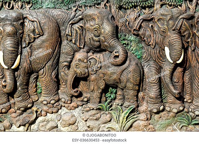 Beautiful elephants carve on wood