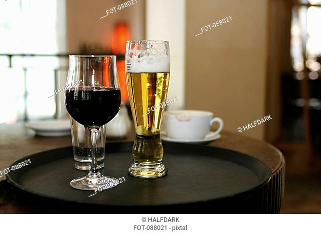Glass of wine and beer on cafe table