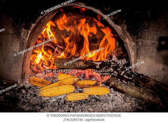 Crilled corn in a traditional wood oven. Pournaria village, Arcadia, Peloponnese, Greece