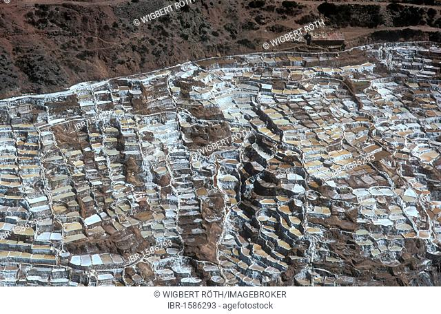 Hundreds of salt terraces on a hillside at Pichingote, salt production by evaporation, already in use during the time of the Incas, Peru, South America