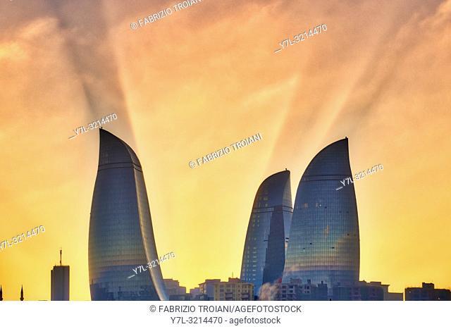 Sun rays behind Flame Towers, Baku, Azerbaijan
