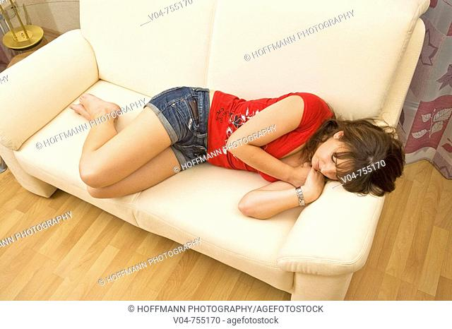 Young woman sleeping on a couch
