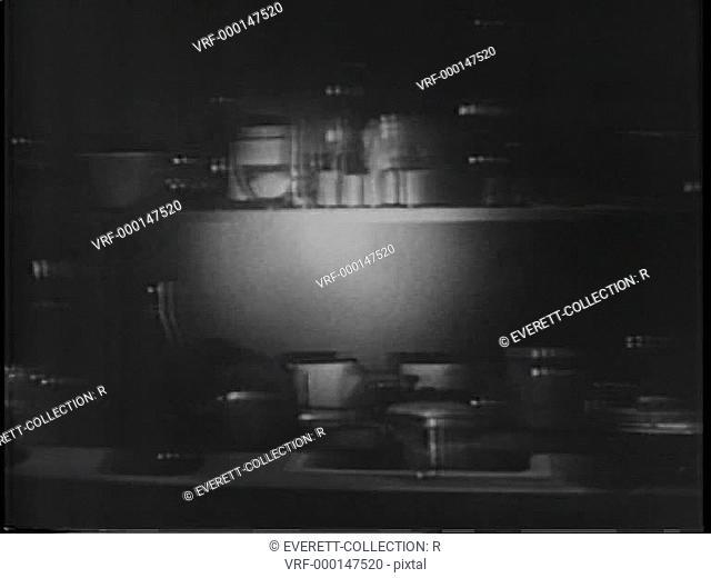 Flashlight shining on flasks in laboratory