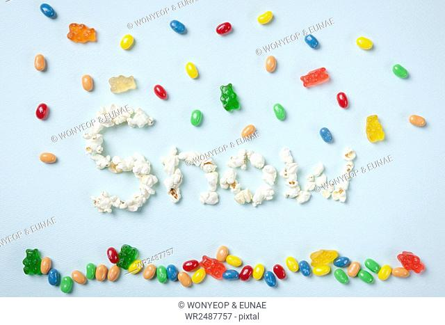 Typographical word of SNOW made of popcorn and jellybeans