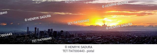Panoramic view of city at sunrise