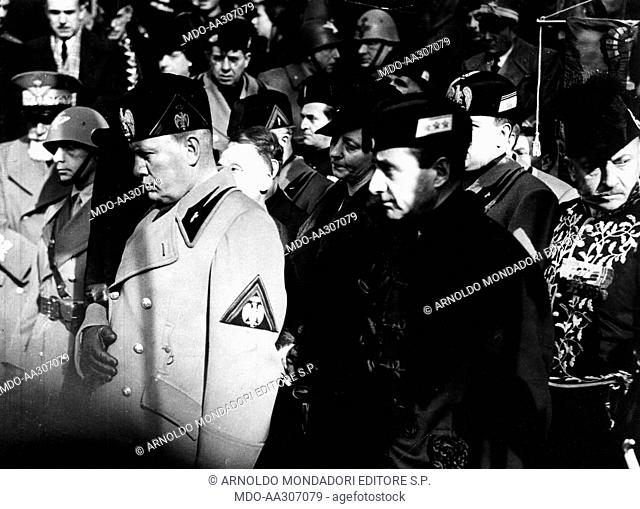 Mussolini and Starace at the funeral of Gabriele D'Annunzio. Benito Mussolini, Achille Starace (Secretary of the National Fascist Party) and other fascist...