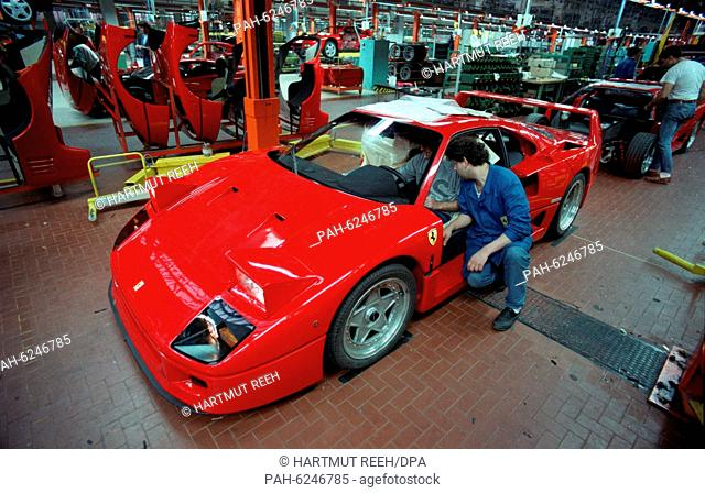 """A F40 Ferrari in the assembly shop of the """"""""Sportwagenschmiede"""""""" in Modena, Italy, recorded in November 1989. 