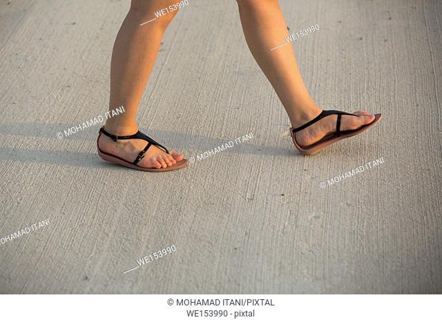 Close up of woman walking outdoors
