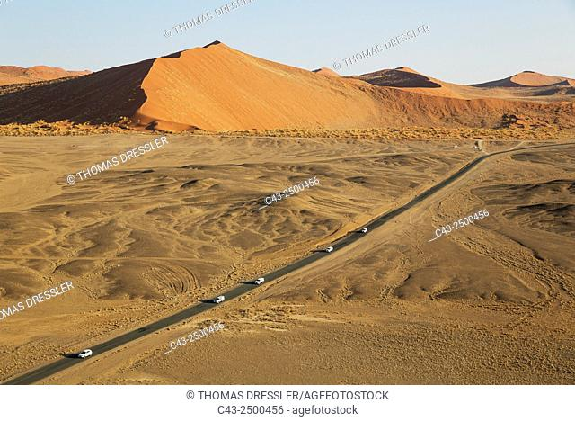 The paved road that connects Sesriem and the famous Sossusvlei in the heart of the Namib Desert skirts some spectacular sand dunes. Aerial view