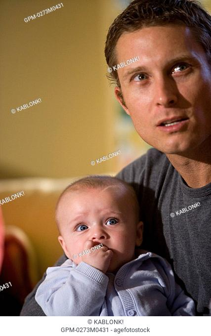 Close-up of father holding baby son