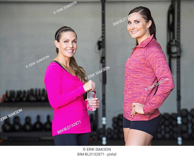 Caucasian women smiling in gym