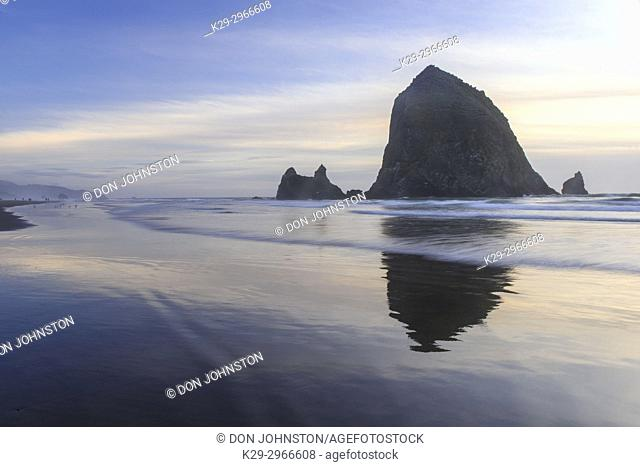 Haystack Rock on Cannon Beach at dusk, Cannon Beach, Oregon, USA