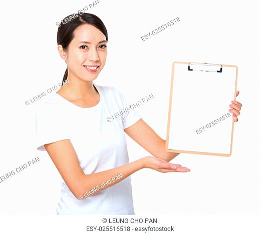 Asian woman showing the blank page of clipboard