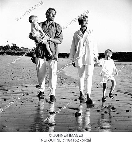 Parents with children on beach