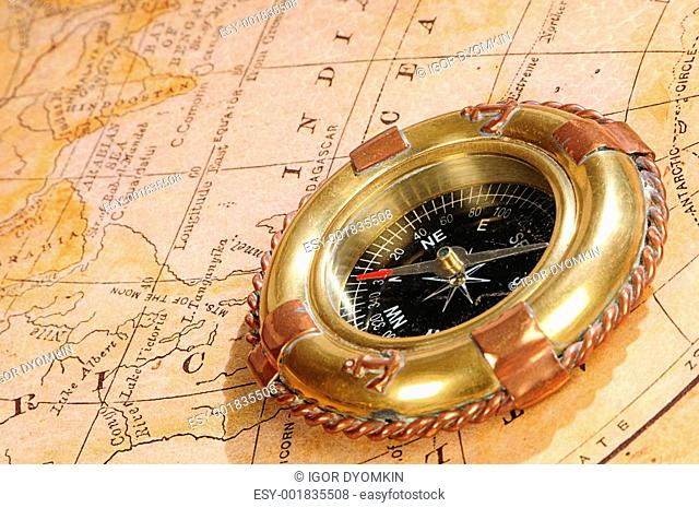 old-fashioned compass on an old map