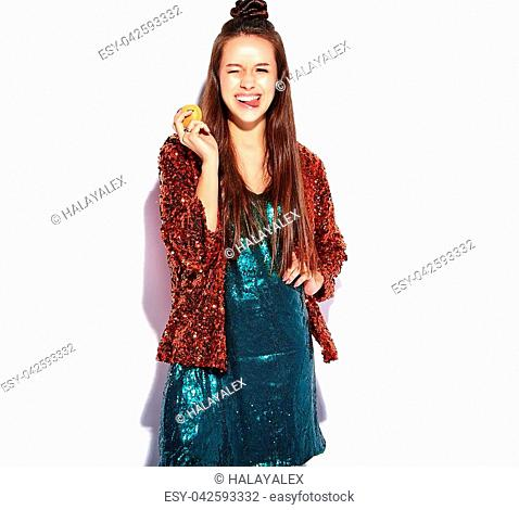 Beautiful caucasian smiling hipster brunette woman model in bright shinny reflecting summer stylish jacket and green dress isolated on white background