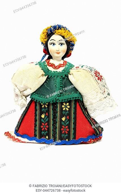 Ukrainian doll with traditional dress on a white background