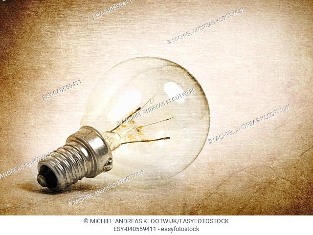 Old lightbulb isolated on a white background - Vintage look
