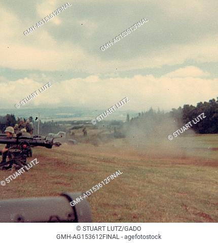Members of the United States Marine Corps fire machine guns in a field in Vietnam during the Vietnam War, 1968. ()