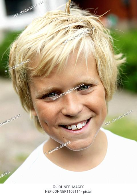Portrait of smiling boy with blond hair