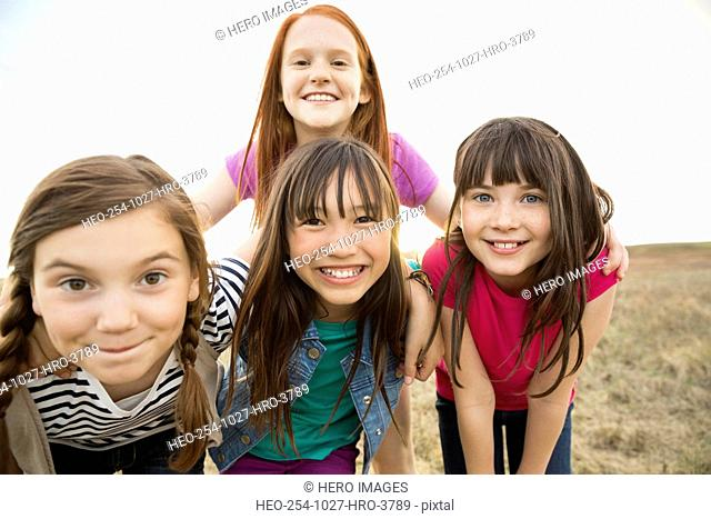 Portrait of cheerful schoolgirls during field trip