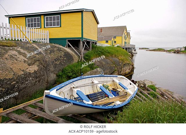 Boat hauled out on the shore at the Barbour Living Heritage Village, Newtown, Bonavista Bay, Road to the Shore, Newfoundland & Labrador, Canada