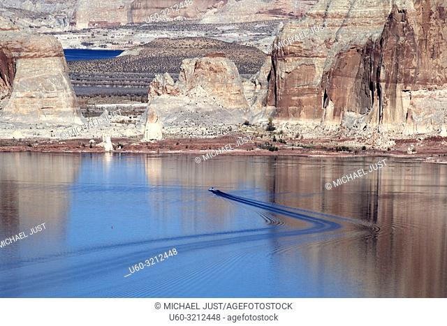 Boaters patrol the calm waters of Lake Powell near Page, Arizona