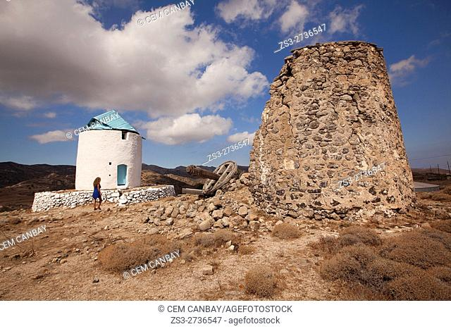 Woman in front of the windmill, Kimolos, Cyclades Islands, Greek Islands, Greece, Europe