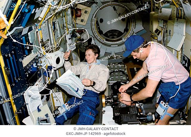 Canadian Roberta L. Bondar, payload specialist representing the Canadian Space Agency (CSA), works at the International Microgravity Laboratory's (IML-1)...