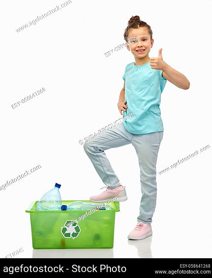 girl sorting plastic waste and showing thumbs up