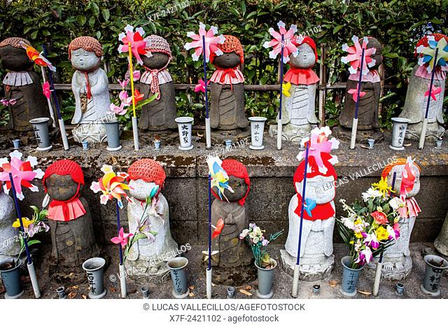Statues of Jizo dedicated to dead unborn children, in Zojoji temple, Tokyo, Japan