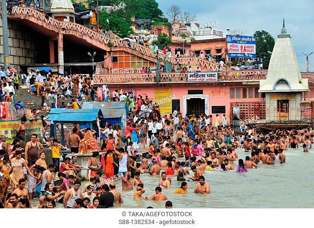 Pilgrims bathing at Har Ki Pairi ghat in the Ganges River