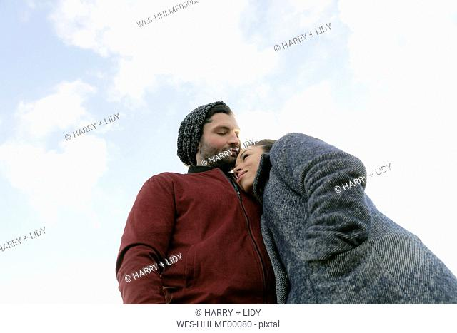 Affectionate young couple outdoors