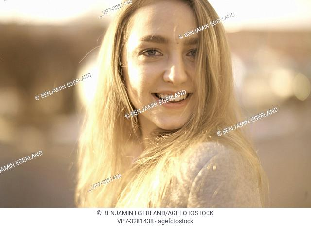 young woman outdoors in sunlight, in Cottbus, Brandenburg, Germany
