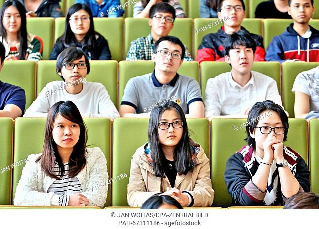 Chinese high-school graduates sit in a lecture hall at the West Saxon University of Applied Sciences of Zwickau, Germany, 08 April 2016