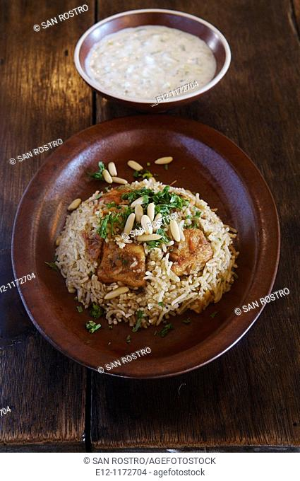 Middle East, Oman, traditional Omani dishes, chicken maqbous or majbous, kind of byriani  always served and mixed in the plate with cucumber yaourt