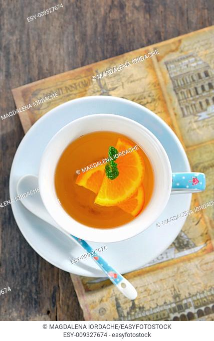 Orange tea in cup with leaf mint