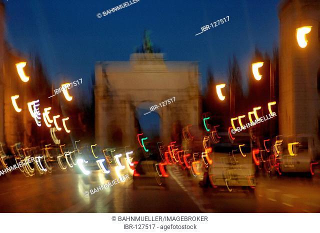 Munich Ludwigstrasse Schwabing Siegestor Bavaria germany by night with lights traffice in movment