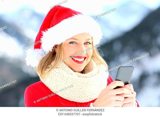 Lady on christmas holidays holding a smart phone